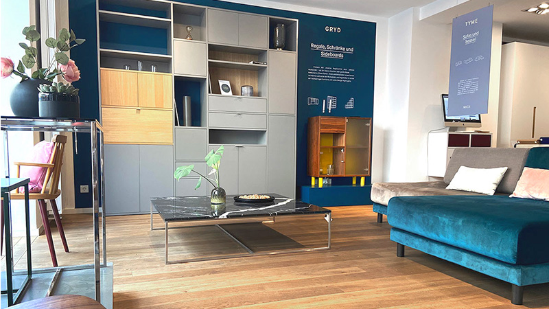 MYCS showroom Munich petrol velvet sofa grey shelf