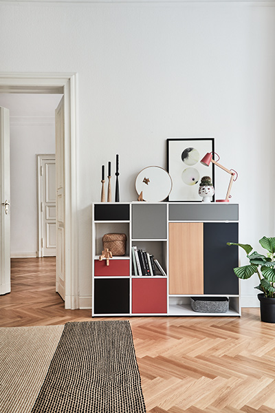 Sideboard in white with drawers and doors in red, beech, grey and black