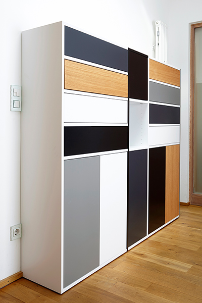 Shoe closet with different coloured doors and drawers