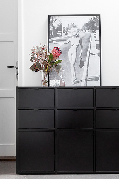 Sideboard in black with six small drawers and three small doors
