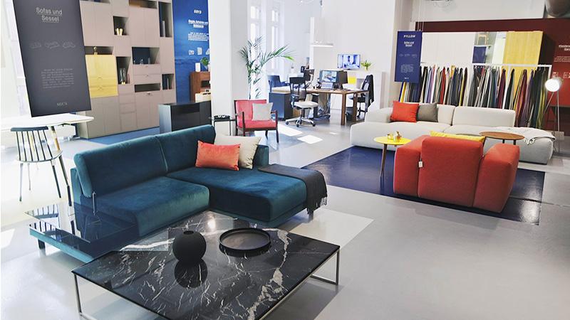 MYCS showroom Hamburg sofas shelf tables
