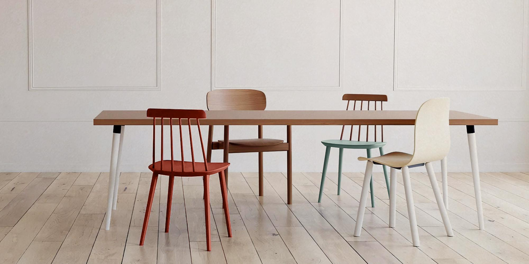 wooden chairs with different designs besides a table