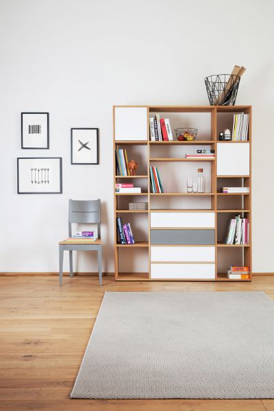 Oak shelf with open and concealed storage and solid oak chair