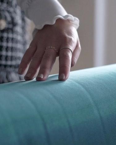 touching blue velvet sofa